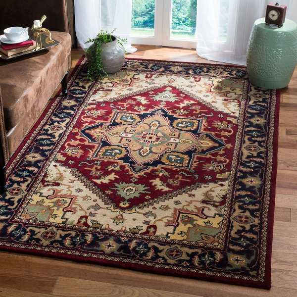 Safavieh Handmade Heritage Traditional Heriz Red/ Navy Wool Rug - 5' x 8'